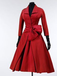 ~'Ecarlate' (scarlet); La Ligne Y    Object:  Cocktail dress    Place of origin:  Paris, France (made)    Date:  1955 (made)    Artist/Maker:  Dior, born 1905 - died 1957 (designer)    Materials and Techniques:  Silk grosgrain, lined with silk, nylon and organza net, and tulle; with metal coil 'boning' in the bodice~