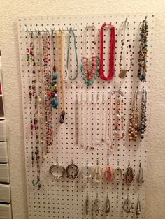 Jewelry organization... I plan to attach burlap or fabric over the peg board before putting the hooks on, then use crown molding to frame it.