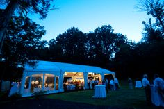 An evening view of the reception tent open to receive guests and the night air.  Chestnut Hill Bed and Breakfast, Orange, Virginia.  www.chestnuthillbnb.com/weddings