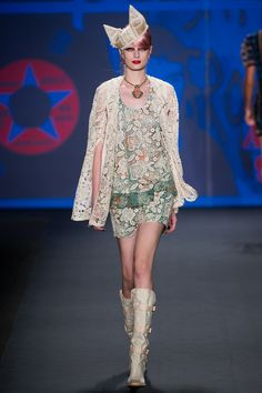 Don't know what the deal is with her head, but lovin' the dress, cardigan and funky belted boots. Anna Sui, Spring 2013.