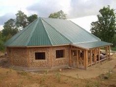 Cordwood oval home with metal roof