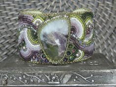 Tourmaline beaded cuff bracelet by TheCharmedRabbit on Etsy. , via Etsy.