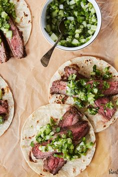 Flank steak tacos with cucumber salsa. 24 Easy-Cheesy Cinco de Mayo Recipes for Your Fiesta. #purewow #cooking #recipe #food #holiday #cheese #mexicanrecipes #cincodemayo #steaktacos #steakrecipes #tacos