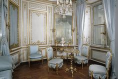 Marie Antoinette's Private Apartments, The Salon Doré, with Neoclassical interior decoration and pompeian inspired furnitures. The floor is made of Versailles Parquet.