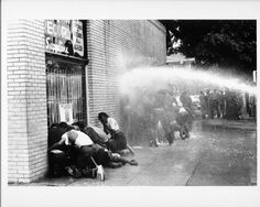 African American children are attacked by dogs and water cannons during a protest against segregation organized by Martin Luther King Jr. and the Rev. Fred Shuttlesworth in May 1963.  Photo credit: Michael Ochs / Getty Images