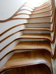 Creative wooden staircase designed by Atmos Studio for nature inspired residential house in London, England.