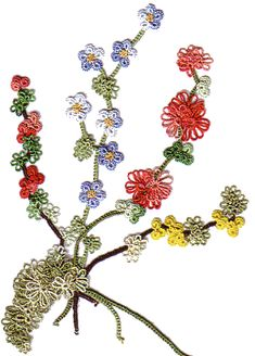 Pretty tatted flowers, I'm going to make a version of this to look like the Larkspur (flower of July)