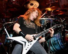 Dave Mustaine - has turned into a bit of a clown lately, but damn can he play (and sing at the same time)