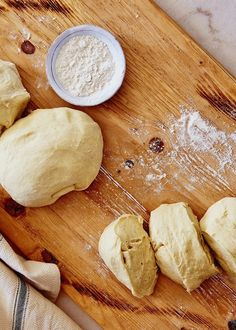 This sweet cardamom bread called Pulla Bread is a staple in Finland. Soft, and aromatic, it has a sprinkling of traditional pearl sugar and almonds to make it even more special. Braided Bread, Bread Bun, Pulla Recipe, Pearl Sugar, Sweet Buns, Bun Recipe, Egg Wash, Sliced Almonds, Baking Sheet