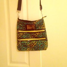 Betsey johnson Crossbody bag Betseyville green and yellow cheetah print Crossbody bag. 3 pockets total with lightening bolt zippers. This has always been one of my favorite bags and it can hold quite a bit inside. So if you're into Betsey Johnson, this is a great bag to have. Betsey Johnson Bags Crossbody Bags