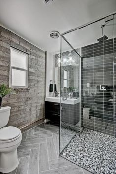 Don't be afraid to mix and match textures and patterns in your bathroom. 4 different types of tiling come together to create a cohesive look here.
