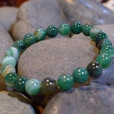GREEN AGATE BRACELET. GREEN AGATE (An All-Around Stone) Its most noticeable properties overall are balancing yin/yang energy, courage, protection, healing, and calming. Agate is a stone of strength. Agate enhances creativity and strengthens the intellect, making it a beneficial stone for both students and artists. It is also known as a good luck stone, a conservation stone, and enhances longevity. Agate is a very protective stone. Its green color translates to wealth and abundance in the…