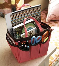 Portable Supplies  -- A crafts-supply tote keeps small office supplies organized and portable.  -- When not needed, the tote tucks back into the storage niche above the desk.