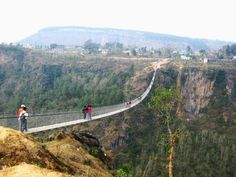Kusma-Gyadi bridge, Nepal. Catenary suspension footbridge, crossing 117 meters above the Madi River with a span of 344 meters. Completed in early 2010.