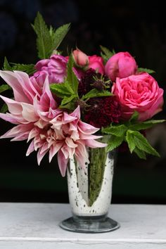 """LOVE:  This mercury glass goblet is filled with pink """"piano"""" roses, cafe au lait dahlias, burgundy scabiosa, purple parrot tulips, and fragrant mint!"""