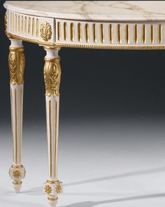 luxury furniture - carved consoles - Louis XVI style carved wood console table in antique white finish with antique gold-leaf accents and Calacatta gold marble top with curved beveled edge