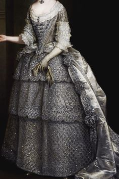 Lady Frances Montagu by Charles Jervas, ca 1734. showing her wearing a mantua with tiered peticoat, all of silver fabric that looks like silk brocaded with silver thread. Gorgeous gown.