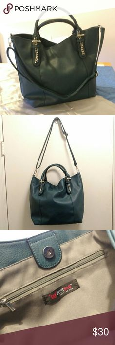 """Justfab James tote in teal An oversized tote that features top handles with embellished detail, a functional top zipper, and an adjustable removable strap. Like new condition, only used it twice. Last photo is for size reference, it is the same bag, but in a different color. The teal color of the bag you are getting is not available anymore.   Material: Faux Leather Size: 17L x 13H x 6.5D Shoulder drop measurement : 7"""" Removable Adjustable Shoulder strap Pockets: 1 interior pocket, 1…"""