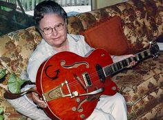"Eddie Cochran's 1955 Gretsch 6120 guitar being held by his Mother ""Alice"" after his death at 21 in an auto accident in England..."