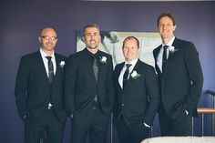 dapper groom and groomsmen in their black suits and ties - love the groom's black shirt!