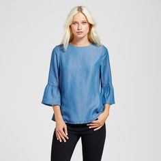 Add some instant charm to your look with this Chambray Bell Sleeve Top from Alison Andrews. The bell sleeves on this blouse bring some dimension to your look. Pair it with black skinny jeans for a chic look or with white denim shorts for a cute and casual style for the next neighborhood block party or barbecue.