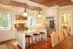 wood plank ceiling in kitchen and foyer