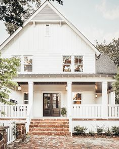 "Bethany Walker on Instagram: ""The used brick got me on this Alabama modern farmhouse. And the hanging pendant lights on the porch. Don't forget to notice the tongue and…"""