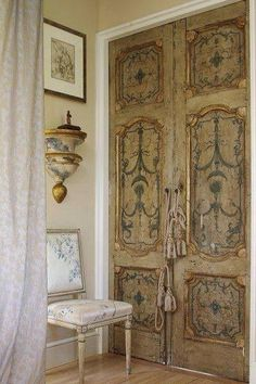 Beautiful interior setting with hand-painted antique doors and carved occasional chair