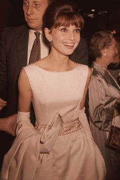 Audrey Hepburn Style: 20 Rare Pictures You've Never Seen - Audrey Hepburn wearing a white satin evening gown and long gloves. Audrey Hepburn Outfit, Audrey Hepburn Mode, Audrey Hepburn Wedding Dress, Divas, Givenchy, Brigitte Bardot, Look Formal, My Fair Lady, British Actresses