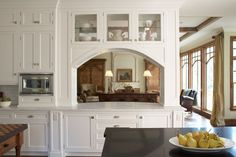 """Love this idea to make the kitchen """"open to"""" the living/family room, without all the mess in the kitchen being """"open to"""" the rest of the common areas."""