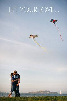 A couple kissing while flying kites in San Francisco, CA