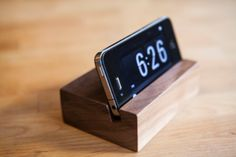 iPhone Stand by solidmfgco, Etsy (for dark walnut see also https://www.etsy.com/listing/152733620/iphone-stand-walnut?ref=br_feed_24&br_feed_tlp=gifts)