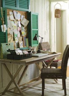 cute little office area... the shutters around the bulletin board make the perfect frame.