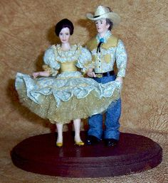 """Square Dancin!...SALE $200......$275/As Shown... This is a pair of square dancers, on a 6"""" plaque. Dressed in matching, tiny print blue and gold, dress and shirt. Her full petticoat is gold sparkle net, has puffy sleeves and neckline ruffles. His western shirt, sports yokes with trim, blue jeans, western boots. and handmade western hat! This is a great gift for a special couple or even suitable as an award for a dancing class or competition. Unique, and OOAK."""