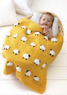 Geel dekentje met witte schaapjes. Zelf breien!