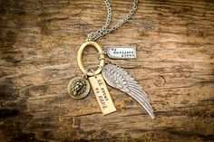 """This stunning 5-charm necklace is inspired by Psalm 91.  """"Whoever dwells in the shelter of the Most High will rest in the shadow of  the Almighty.""""  This message speaks: I will be bold and courageous (lion).He knows my  name.I am protected and covered (wing). The Presence of God i"""