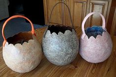 Paper mache dinosaur egg treat bucket to go with triceratops costume.
