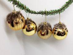 gold and pheasant feather baubles Christmas tree decorations Santa Decorations, Christmas Tree Decorations, Christmas Tree Baubles, Christmas Crafts, Feather Crafts, Feather Wreath, Pheasant Feathers, Xmas Wreaths, Country Crafts