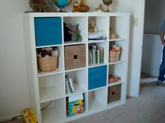 Our Expedit shelf (also known as the Divorce Shelf) in our living room is going to serve as a repository for bebe toys.  I need to find these blue bins.  I have one black one made for it that fits, and I fear Ikea doesn't offer the fun colors anymore.