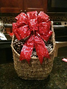 Create some holiday cheer when you fill one of our magazine baskets with cinnamon scented pine cones and top off with a beautiful bow!