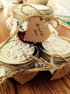 "Individual homemade strawberry jam jars, with ""Spread the love"" labels. Great bridal shower/wedding favor"