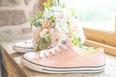 This bride wore her pretty pink converse.