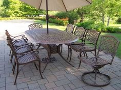 Oakland Living Mississippi Cast Aluminum 82 by 42-Inch Oval 9-Piece Dining Set with Swivels Plus 9-Feet Tilting Beige Umbrella and Stand Oakland Living http://www.amazon.com/dp/B005KHFI7I/ref=cm_sw_r_pi_dp_xJO1wb0RC7V81