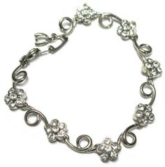 "White Crystal Flowers Swirl Silver Rhodium Plated Link Bracelet 7"" Kids Jewelry USA. $9.31. 7"" Length. Silver Rhodium Plated. Free Jewelry Pouch Included. Save 60% Off!"