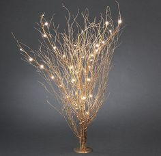 gold colored twigs with led lights/Christmas lights. Good for winter wedding.
