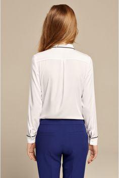 Biała koszula z czarną lamówką