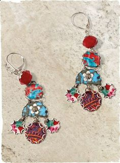 Colorful earrings cascade bits of bright fabric set in metal frames and topped with crystal beads.