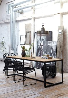 The lines of the table work well with the uprights of the large artworks