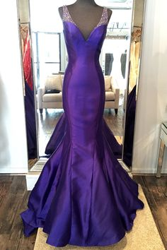Fit and flare evening gown with a gorgeous long train. Hand beaded straps on silk mikado. Please contact us for more information and delivery on this dress. This dress fits 1 size smaller than other s