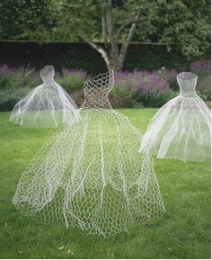 Etherial Lawn Ghosts: Painted chicken wire sculptures.